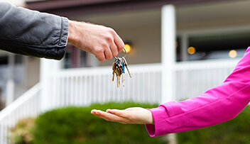 Stock photo - man passing keys to woman.