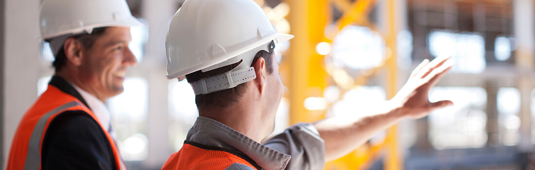 stock photo - two men in hard hats at construction site
