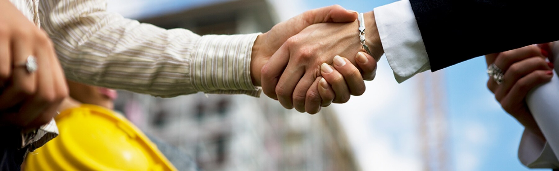 Stock photo - two people shaking hands
