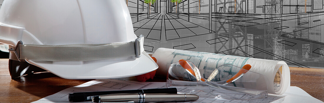 stock photo - hard hat and blueprints